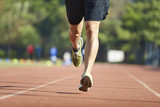 young asian male athlete running on track - 221743661