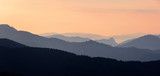 Foggy Sunrise in the Mountains. Mountain panoramic landscape.  - 221746435