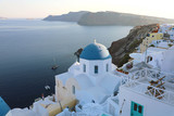 Santorini traditional greek white village with blue domes of churches, Greece - 221747670