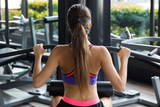 Woman doing exercise for her back - Lat pulldown - 221748837