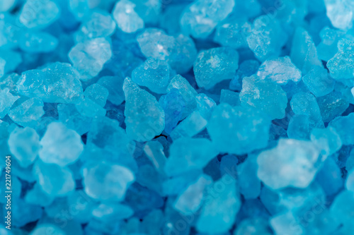 Background macro shot of blue crystals of salt, mineral or chemical reagent, copy space - 221749604