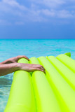 Swimming color green mattress on turquoise sea - 221751815