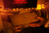 Christmas gift in hands - 221753096
