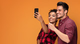 Mixed race couple taking selfie. - 221755660