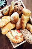 Fresh bread on wooden table - 221777497