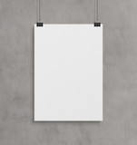 Blank white poster hanging up with clips mockup - 221784075