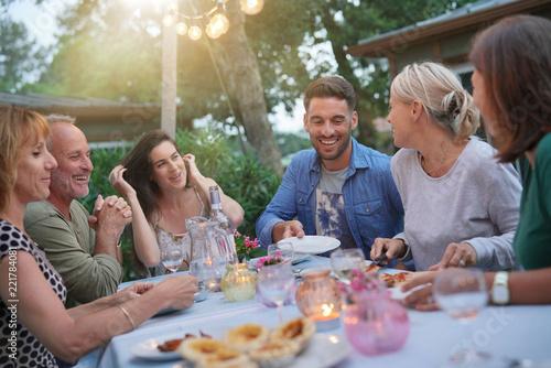 Foto Murales Friends enjoying summer barbecue dinner in garden