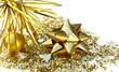 golden star-shaped ribbon on glitters and christmas ball on white background
