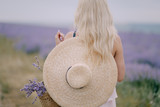 girl in a hat on a lavender field - 221794080