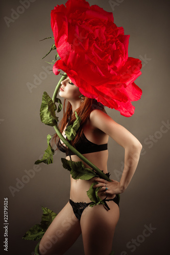 woman in underwear with big rose flower