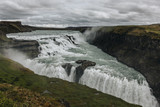 aerial view of beautiful Gullfoss waterfall flowing through highlands in Iceland