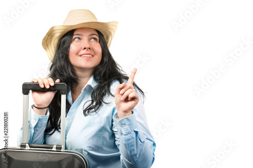 406118db Beautiful young brunette woman wearing hat with suitcase isolated on white  background. Copy space.