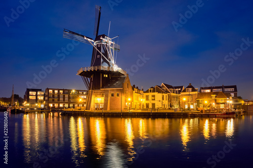 Leinwanddruck Bild Harlem landmark windmill De Adriaan on Spaarne river. Harlem,