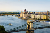 Hungarian Parliament and Budapest landmark view by Danube river at sunset - 221804235