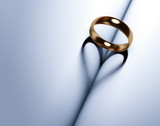 Wedding ring forms a heart-shaped shadow - 221808800