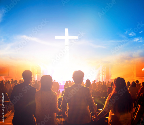 Worship concept:Silhouette people looking for the cross on  sunrise background © paul
