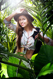 portrait of nice young woman  exploring jungle environment - 221823032