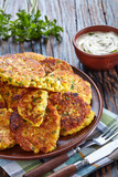 baked corn fritters on a plate - 221839649