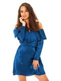 Beautiful brunette woman in blue dress - 221843451