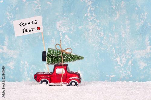 Leinwandbild Motiv Weihnachtstanne holen