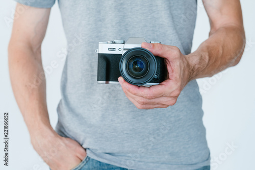 Fototapeta photography art. creative hobby and inspired leisure. unrecognizable man holding photo camera in hands.