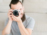 photography art. hobby creativity and inspiration. photographer leisure and lifestyle. man holding photo camera in hands and looking through lens. - 221866863