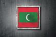 Maldives flag in concrete wall