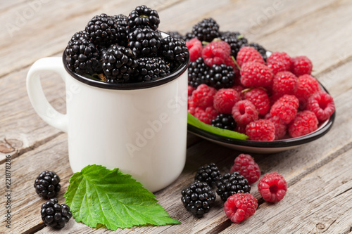 Cup of ripe blackberries and raspberries - 221878286
