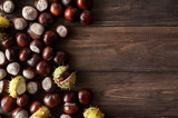 Fruits of horse chestnut on a wooden background. Horse chestnut tree. Space for text. - 221880266