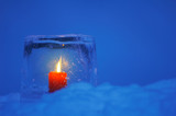Ice lantern with red candle burning in winter evening twilight. - 221883469