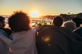 Friends having sunset beach party
