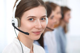 Call center. Beautiful cheerful smiling operator consulting clients with headset. Business concept of customer service - 221896259