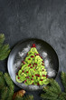 Edible christmas tree from kiwi slices.Top view with copy space. - 221901075