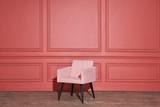 Nice soft pink armchair stands in studio - 221908471