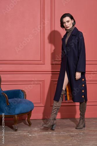 Leinwandbild Motiv Model posing in studio in trendy clothes