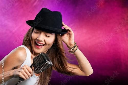 Leinwandbild Motiv Elegant woman singing