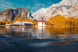 Lake Königssee with St. Bartholomä pilgrimage chapel in fall, Bavaria, Germany - 221914085