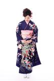 portrait of young asian woman wearing purple kimono on white background - 221918202