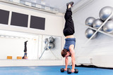 Young muscular man doing crossfit exercises in a gym - 221922205