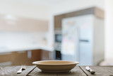 empty plate with fork and knife on wooden table - 221926802