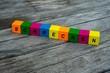 Farbige Holzwürfel mit Buchstaben auf dem das Wort Schrecken abgebildet ist, Abstrakte Illustration - 221930464