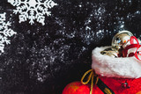New Year boot and snowflakes on dark background - 221931427