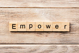 empower word written on wood block. empower text on table, concept - 221945804