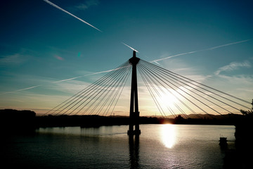 Cute sunset with Donaustadt bridge and sky background in Wien, Austria. Concept of Danube landscape in Vienna, cheap tours for summer in Europe. © sisterspro