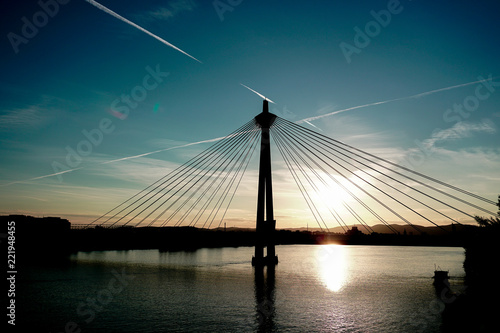 Cute sunset with Donaustadt bridge and sky background in Wien, Austria. Concept of Danube landscape in Vienna, cheap tours for summer in Europe. - 221948455