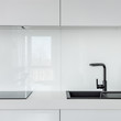 White kitchen with black sink