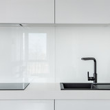 White kitchen with black sink - 221951044