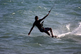 Kite surfing on the sea. An extreme sport. - 221952616