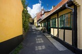 Traditional colorful half-timbered houses in Gudhjem, Bornholm, Denmark - 221953034