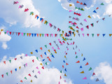 Festival outdoor colourful flags decoration with blue sky background - 221955845